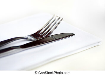 Knife and fork on restaurant table