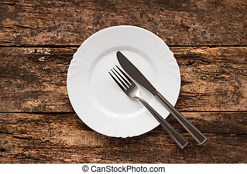 knife and fork on the plate are the symbol of the end