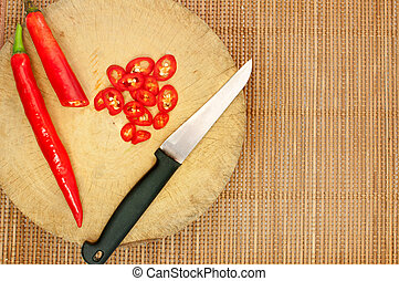 Knife and red chilli on cutting board , cooking concept