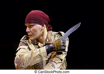 knife combat - man with knife on dark background