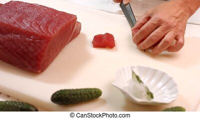 Knife cuts raw meat.