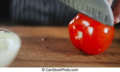 Knife Cuts Tomato On Wooden Board