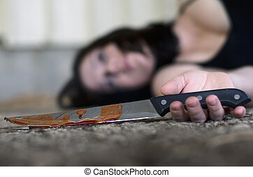 Knife Hand Violence - Conceptual image of a dead woman...