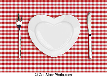 Knife, heart plate and fork on checked tablecloth