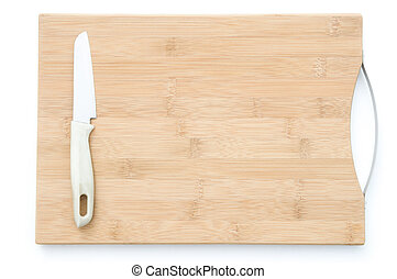 Knife on a wooden chopping board with clipping path