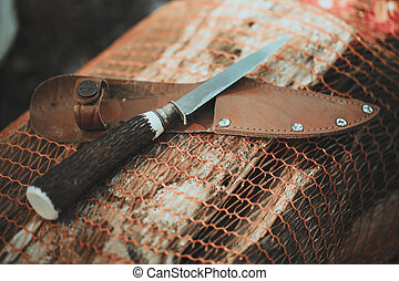 Traditional finnish knife puukko on wooden background