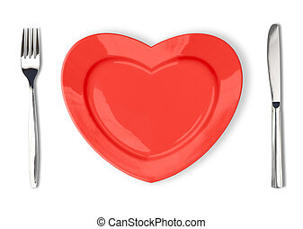 Knife, red plate in heart shape and fork isolated on white