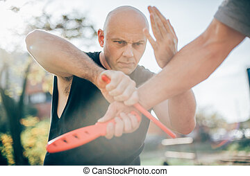 Knife vs knife. Kapap instructor demonstrates fighting and...