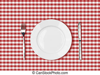 Knife, white plate and fork on red picnic table cloth
