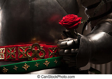 Knight giving a rose to lady