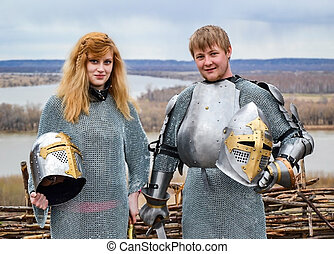 Knight with his wife in armor and chain mail.