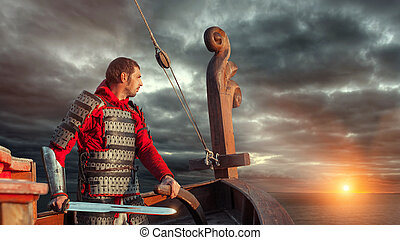 Knight with the sword navigate a warship on the sunset background