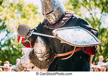 Knights In Fight With Sword. Restoration Of Knightly Battle...