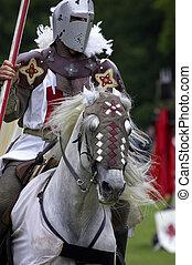 Knights jousting warwick castle England uk