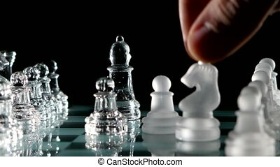 Knight's move in chess on black background. Rotation cam