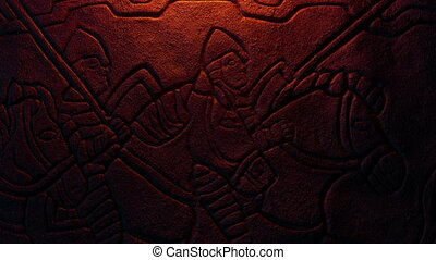 Knights on horseback in firelight detail of stone carving