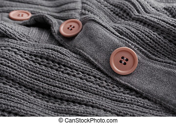 Knit sweater closeup button
