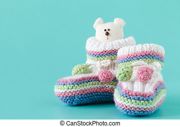 Knitted baby booties with toy