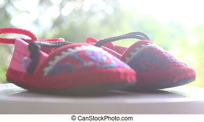 knitted baby shoes with embroidered national