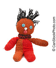 Old handmade knitted doll isolated on white
