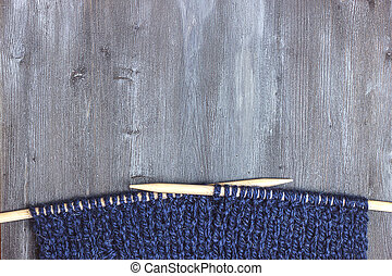 Knitted scarf of woolen blue thread