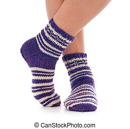 Knitted socks - Legs of caucasian woman in knitted warm...