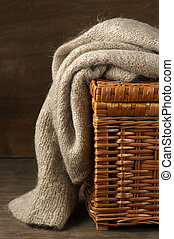Knitted sweater - Fluffy knitted sweater on wicker basket.