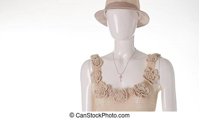 Knitted tank top with hat. Female mannequin wearing knitted...