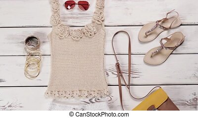 Knitted tank top with sandals.
