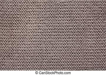 Knitted textile background in stylish grey hue.