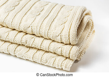 Knitted white scarf with a pattern of braids