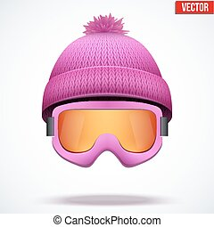 Knitted woolen pink cap with snow goggles. Winter seasonal ...