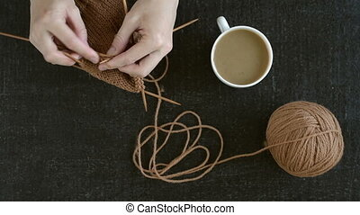 Knitting a sock with coffee