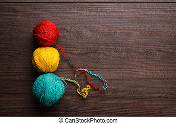 knitting balls of threads - colorful ball of threads on...