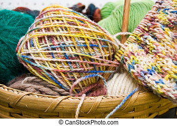 Knitting Basket - Variegated yarn and knitting needle in...
