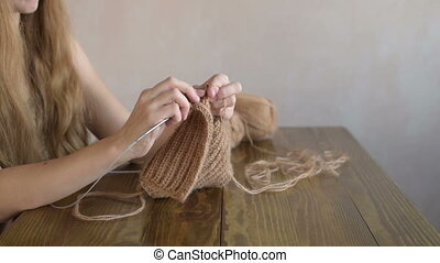 Knitting blonde woman
