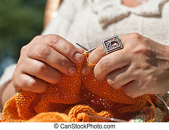 Knitting closeup - Woman hands doing knitting closeup