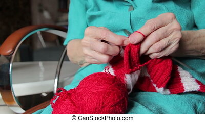 knitting hands of old woman