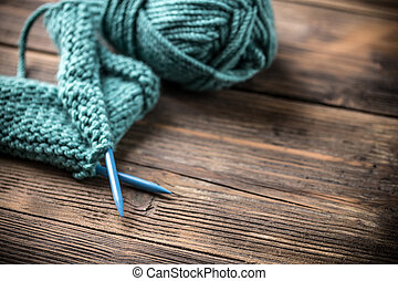 Knitting - Incomplete knitting project with ball of blue ...