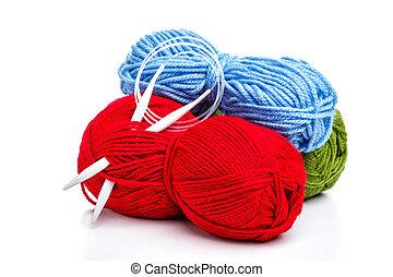 Knitting needle and yarns on white
