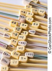 A short depth of field shot of random knitting needles.