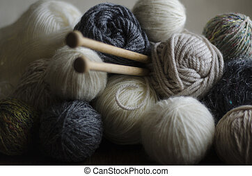 Knitting Needles and Wool - Closeup of balls of wool in...