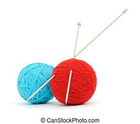 Knitting needles and yarn - Knitting needles and a balls of...