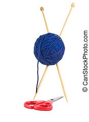 Two wooden knitting needles, pierced through navy blue ball of wall, 'standing' astride red handled scissors.