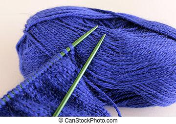 knitting a blue sweater
