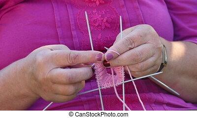 Knitting socks - Grandmother knits socks for little...