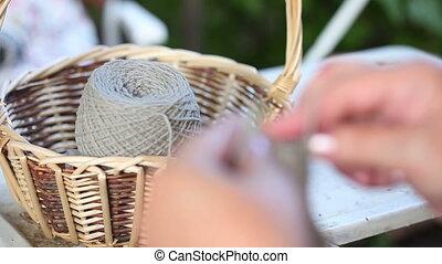 Knitting socks - Woman knitting grey socks. Close-up. Rack...
