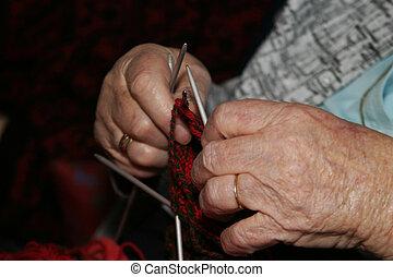 Knitting - An old woman knitting