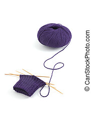 Knitting on four double pointed bamboo needles to make a...