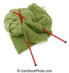Knitting yarn and red needles, with scarf inprogress. Green...